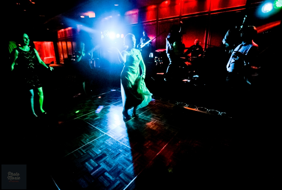Sometimes zen photo moments happen when the bride gets her groove on among blue lights and dancing guests.