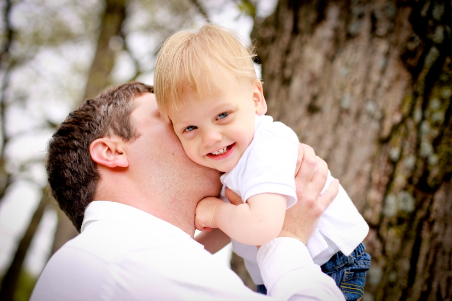 A kiss from Dad can result in smiles.